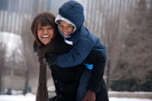 Mother and son having fun in Chicago during the winter.