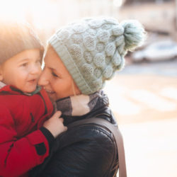 Photo of mother and son enjoying a winter day in the city
