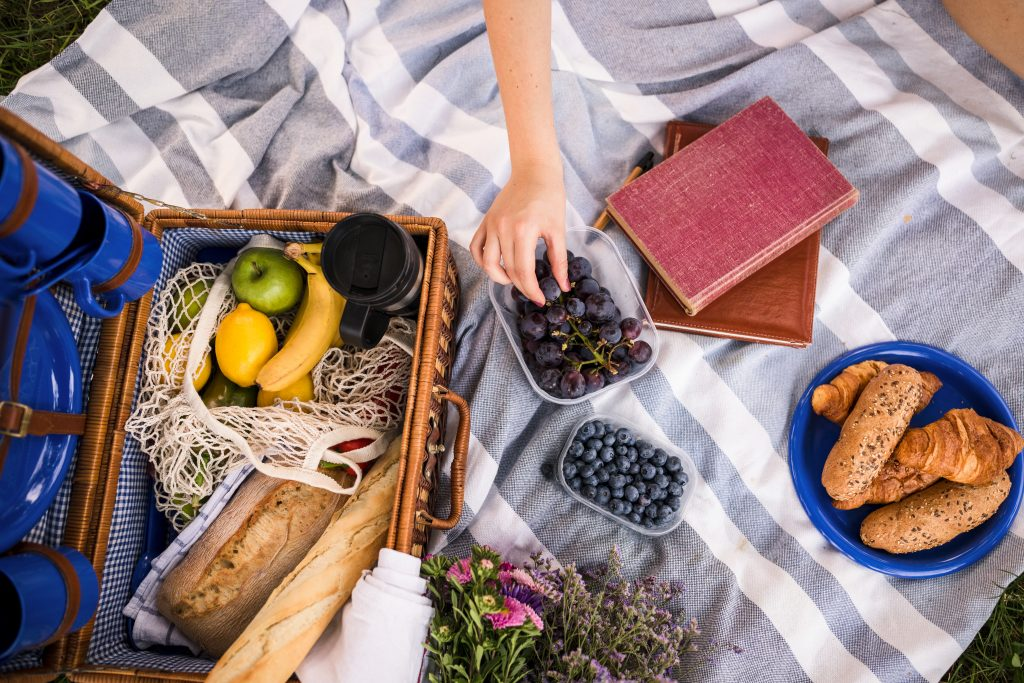 picnic blanket with fruits and bread to share