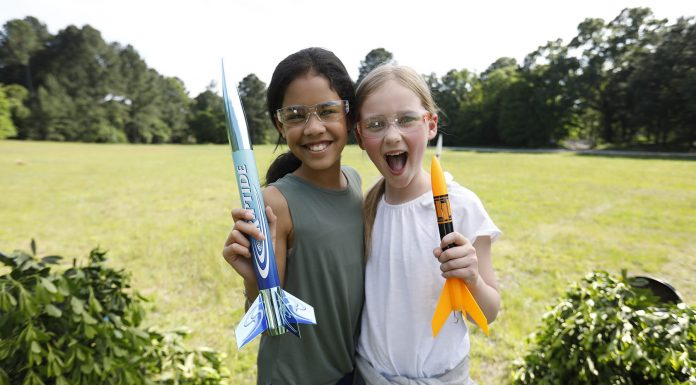 two Cub Scouts holding model rockets -Cub Scouts Fall Day Camp C