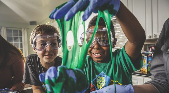 Two boys performing a science experiment with the Cub Scouts