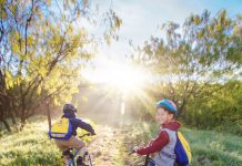 What Scouting Means - boys riding bikes in the sun